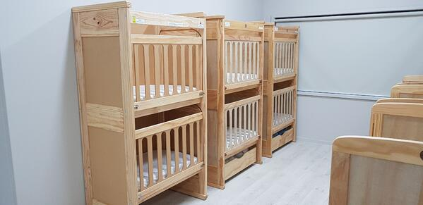 Space saving multilevel cots